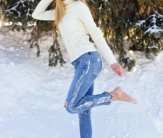 Cute Beautiful Teen Girl Posing Barefoot In The Snow In The Park Stock Photo