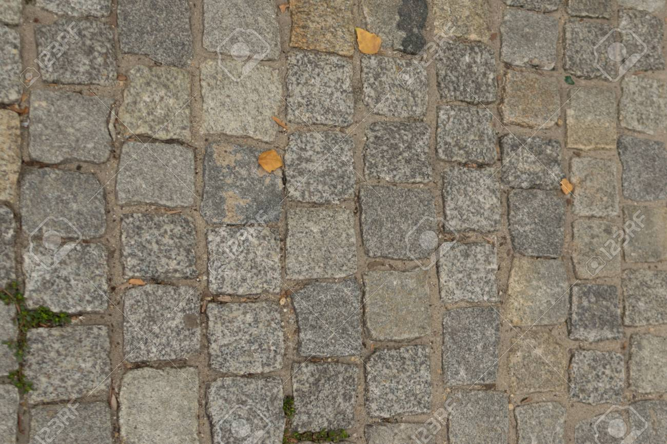 grey old pavement top view or granite cobblestone road ancient