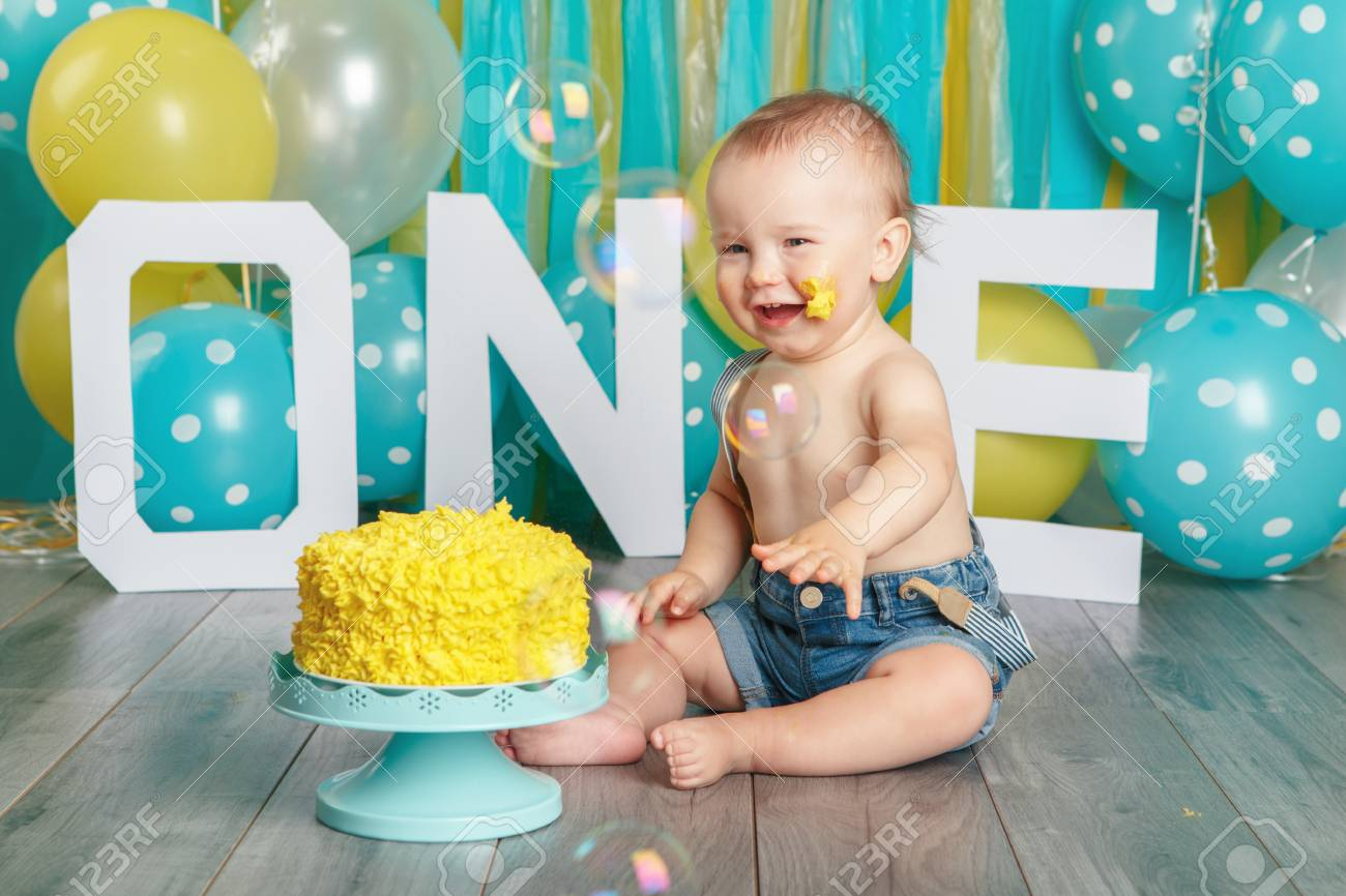 Portrait Of Cute Adorable Caucasian Baby Boy In Jeans Pants Celebrating Stock Photo Picture And Royalty Free Image Image 101719955