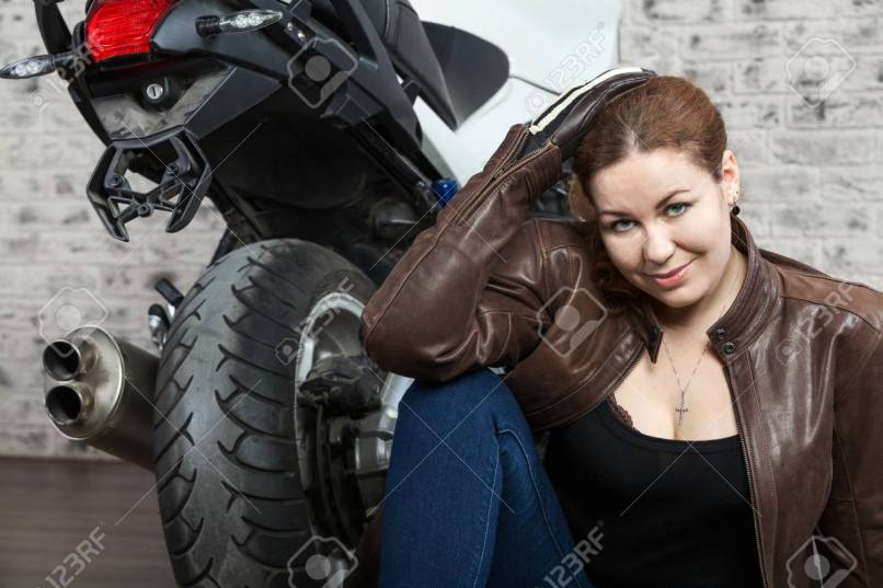 Beauty Female Motorcyclist With Caferacer Vintage Style Clothes