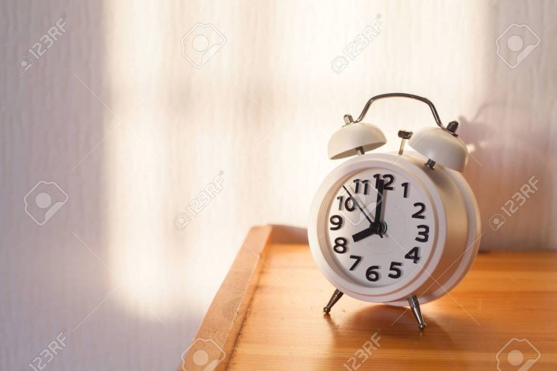 Simple Alarm Bedside - 77095847-eight-o-clock-in-the-morning-alarm-clock-on-bedside-table  Trends_59730.jpg