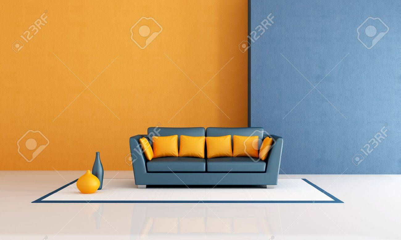 modern sofa with pillow in a minimalist blue and orange living