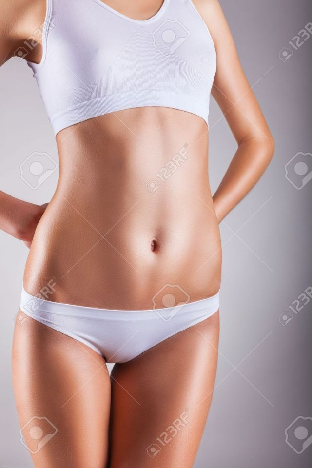 Body Of Young Woman In White Panties On A Gray Background Stock Photo 36732535