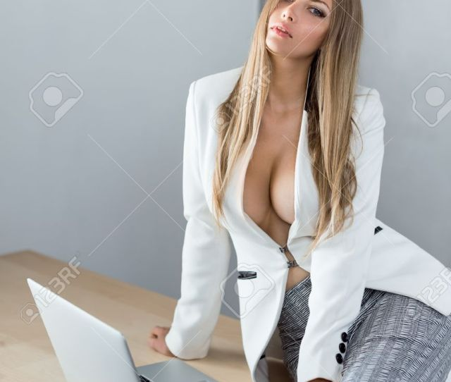 Sexy Business Woman Or Secretary With Notebook Computer Pc Wearing White Suit With Decollete Big Breast
