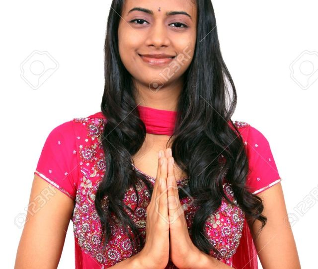 A Beautiful Young Indian Girl In Namaste Pose Stock Photo
