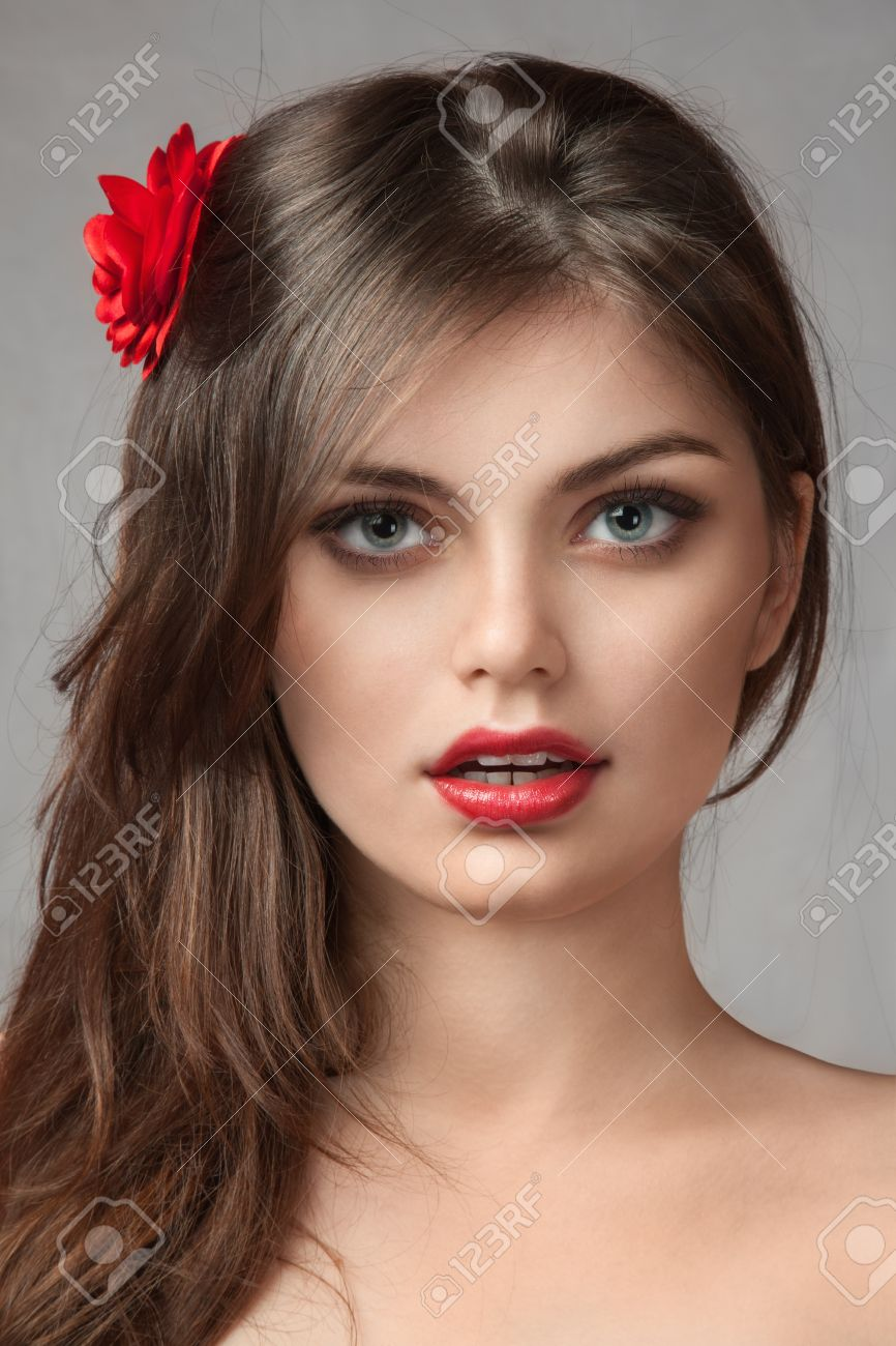 Face Of Sexy Young Girl With Red Flower In Hair Stock Photo 12285790