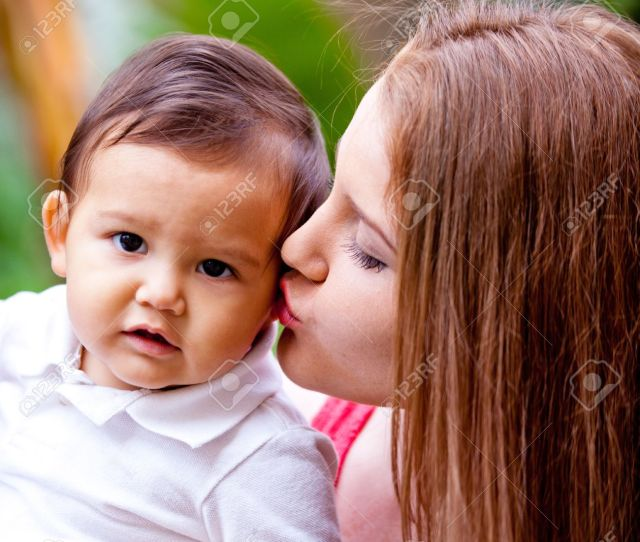 Pretty Young Mom Kissing Her Baby Boy Stock Photo