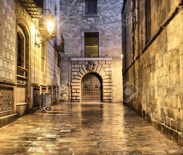 Stock Photo Wet Narrow And Dark Street In Gothic Quarter Barcelona Spain