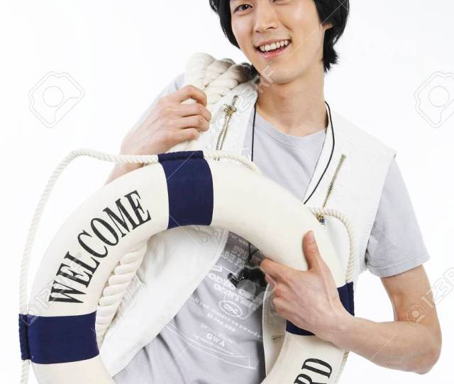 Stock Photo Young Male Asian In Summer Outfit Posing In A Studio With Life Tube Prop