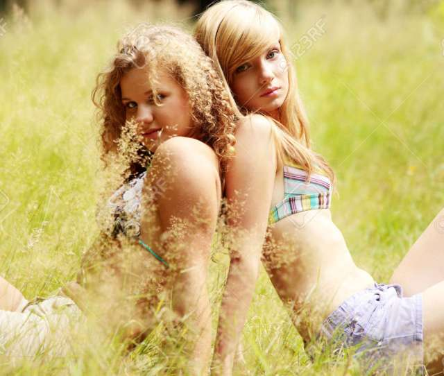 Stock Photo Young Teen Womans Looking At Camera On Hot Summer Day