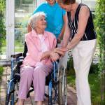 Two Care Takers For Elderly On Wheel Chair In Outdoor Capture With Glass Building At Background Banco De Imagens Royalty Free Ilustracoes Imagens E Banco De Imagens Image 32263639