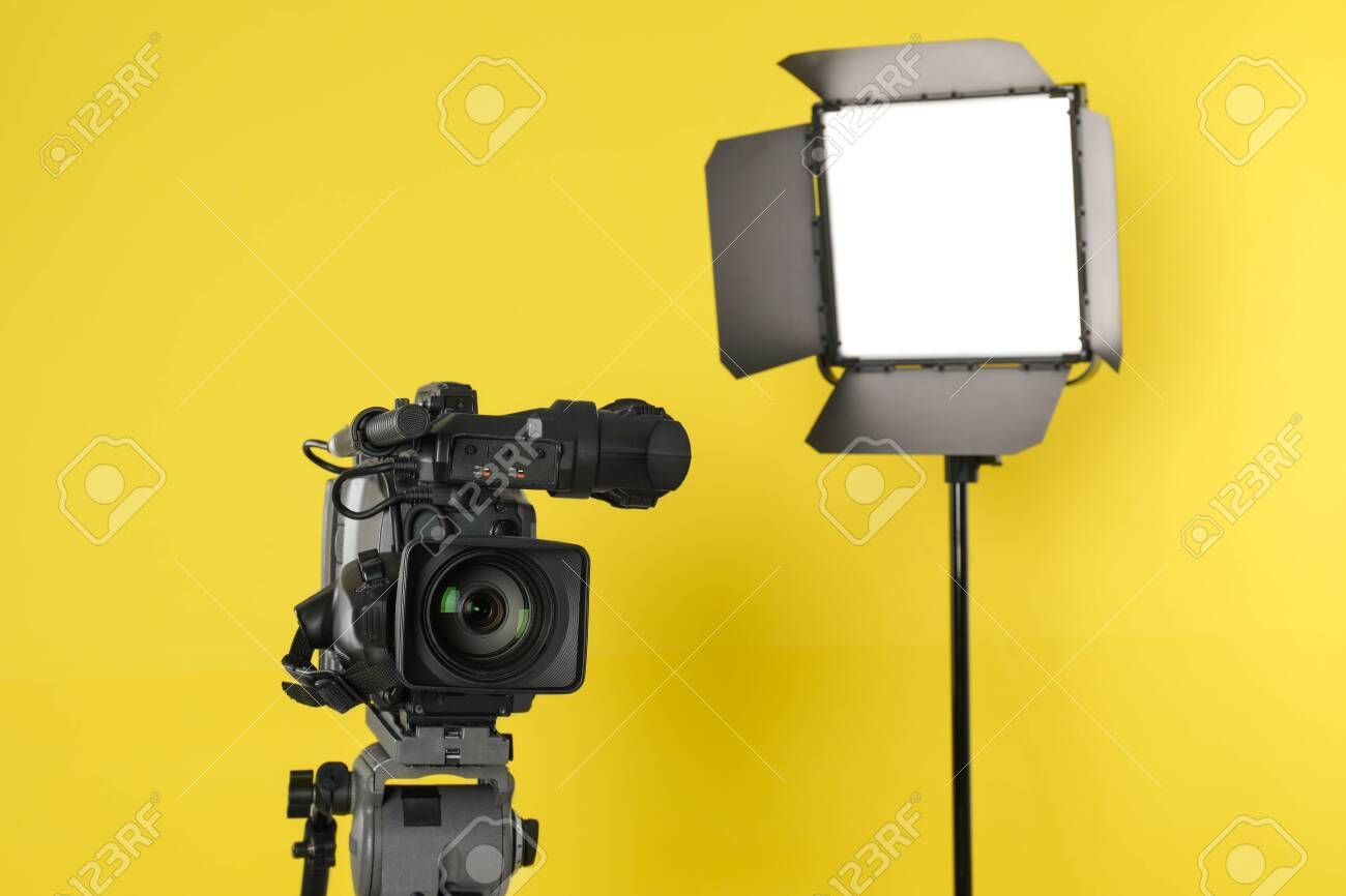 professional video camera and lighting equipment on yellow background stock photo picture and royalty free image image 137589640