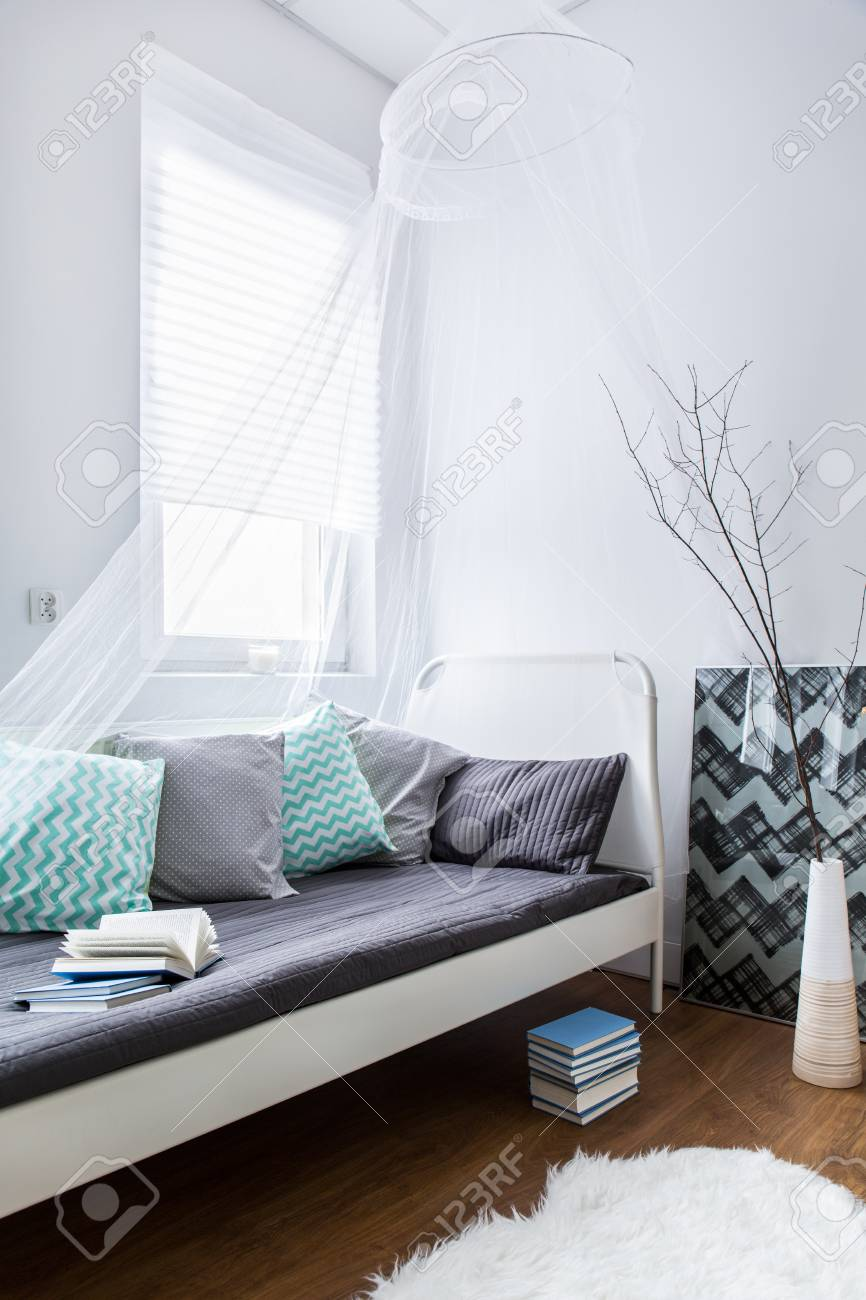 modern decor of room with small white single bed with colorful stock photo picture and royalty free image image 54190192