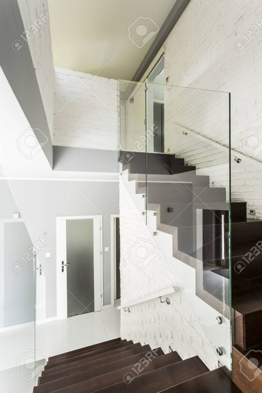 White Staircase With Wooden Stairs Glass Balustrade And Chromed | White And Glass Staircase | Before And After | American White Oak | Luxurious | High End Glass | White Handrail Treads
