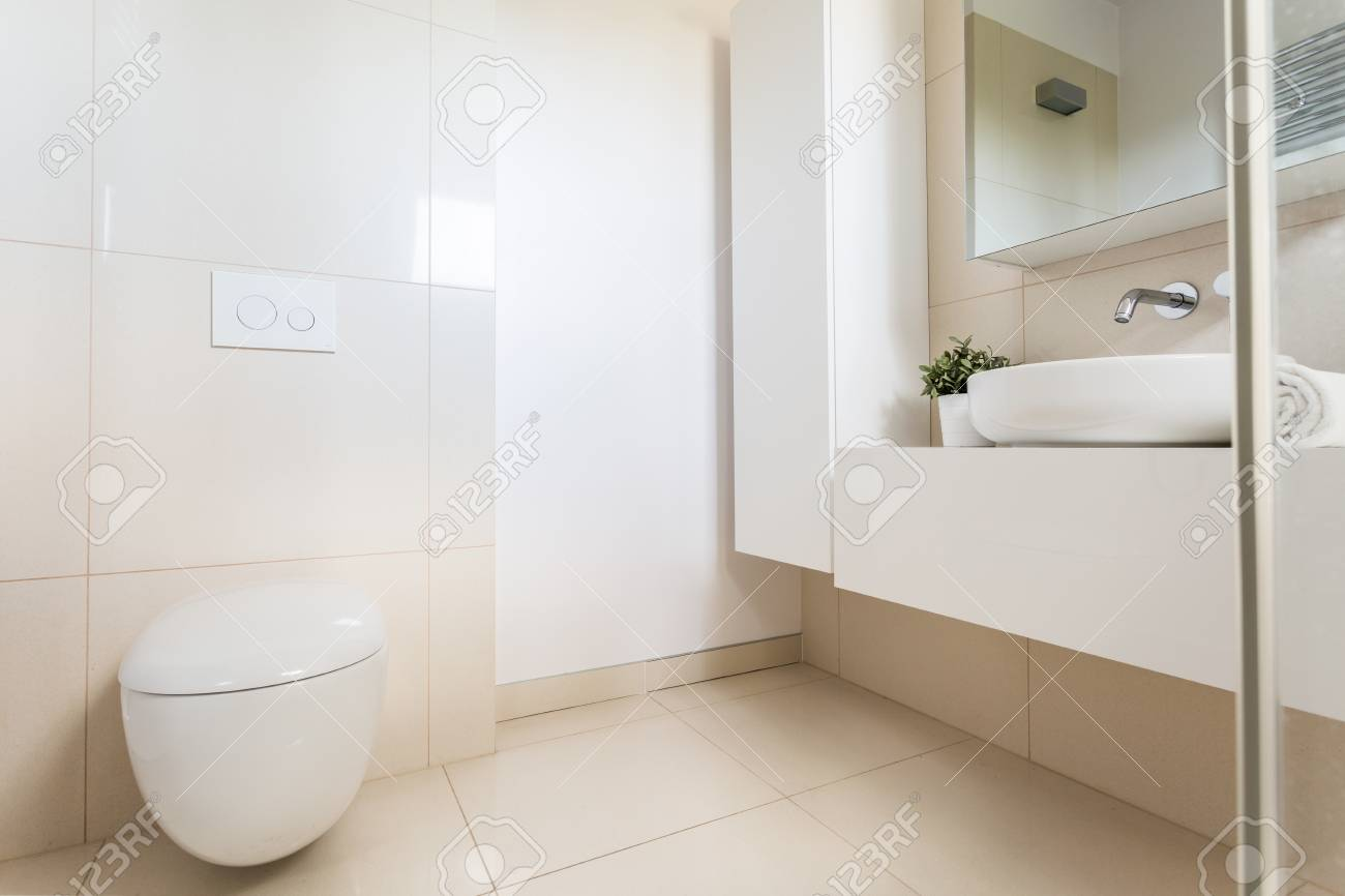 minimalist bathroom with bright marble tiles modern toilet stock photo picture and royalty free image image 67277805