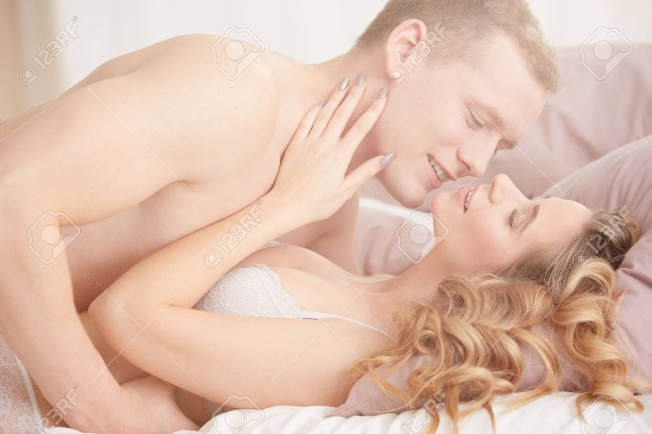 Stock Photo Young Loving Couple Having Sensual Sex In Bright Bedroom