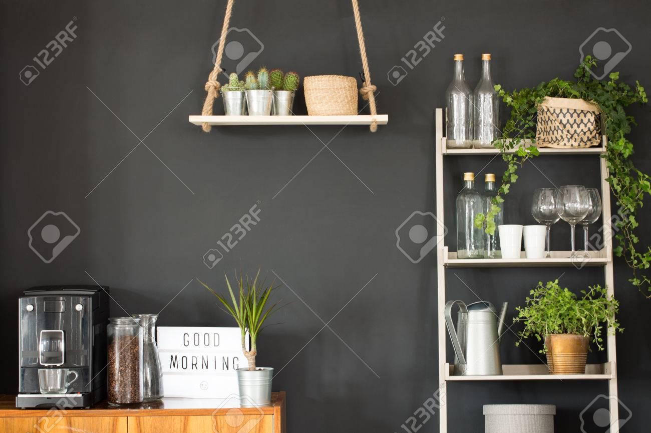 Modern Kitchen With Black Wall Swing Shelf And Ladder Bookcase