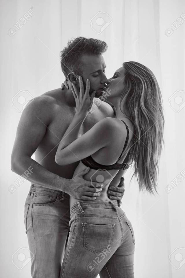 Sexy Passionate Lovers Kissing And Standing Against White Curtain Stock Photo 88036561