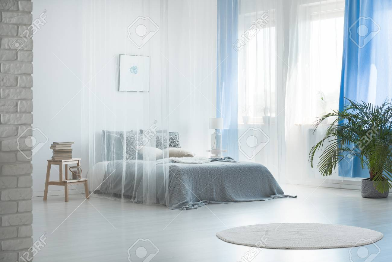 cozy romantic interior design of spacious pale blue bedroom with stock photo picture and royalty free image image 90163679