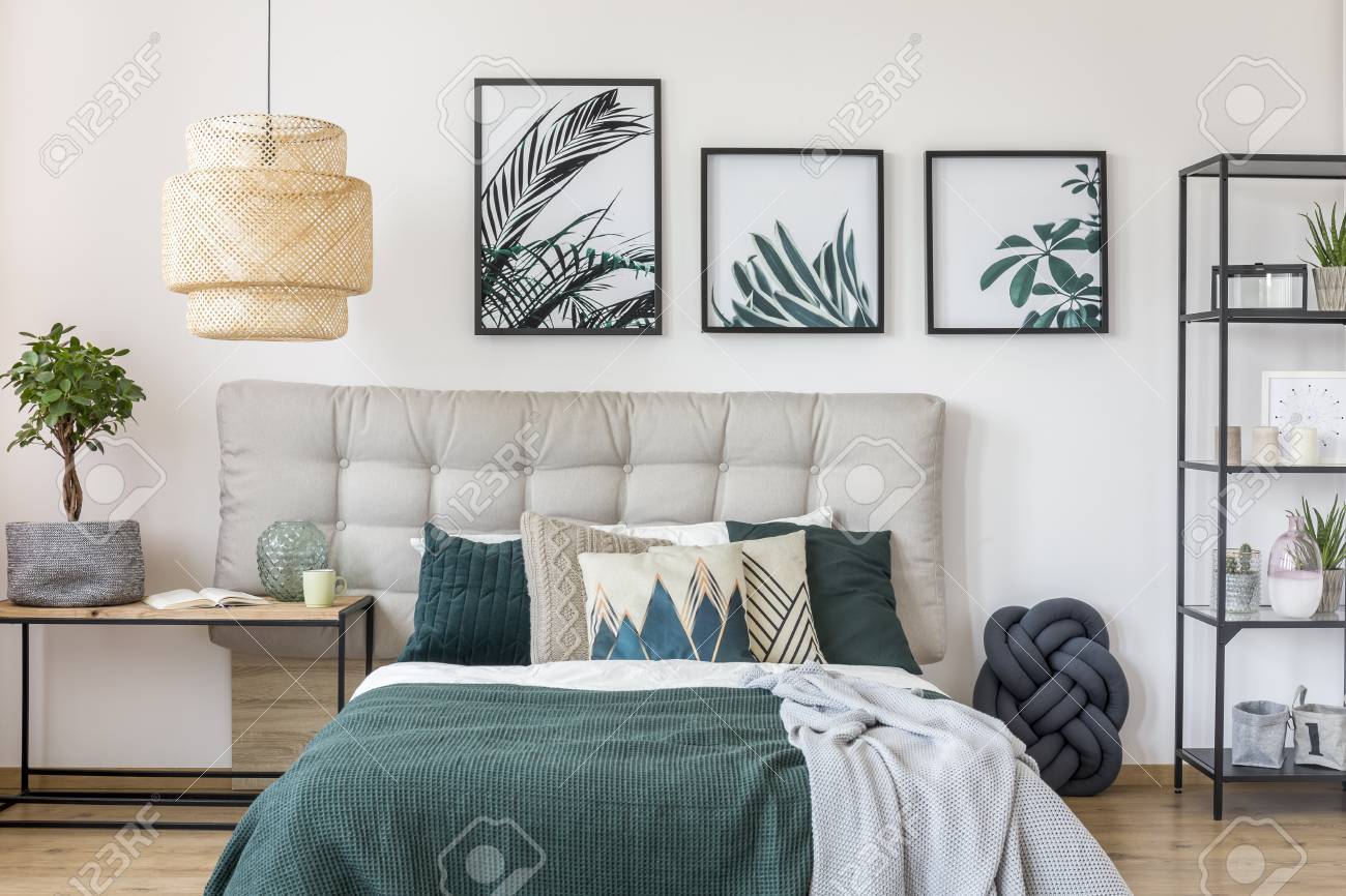 patterned cushions and grey and green blanket on bed against stock photo picture and royalty free image image 92949884