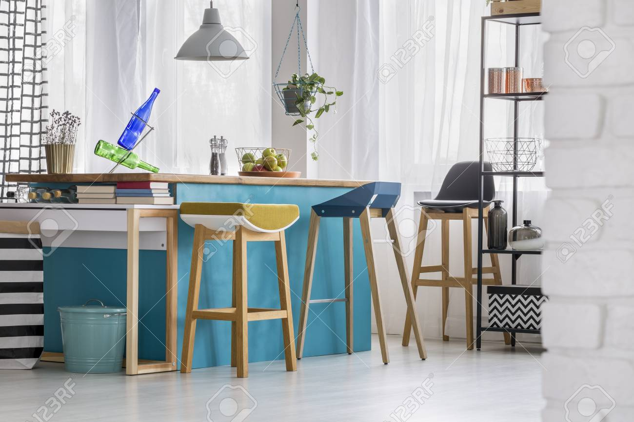 Designer Bar Stools At Blue Kitchen Island With Bottles Under Stock Photo Picture And Royalty Free Image Image 93297317
