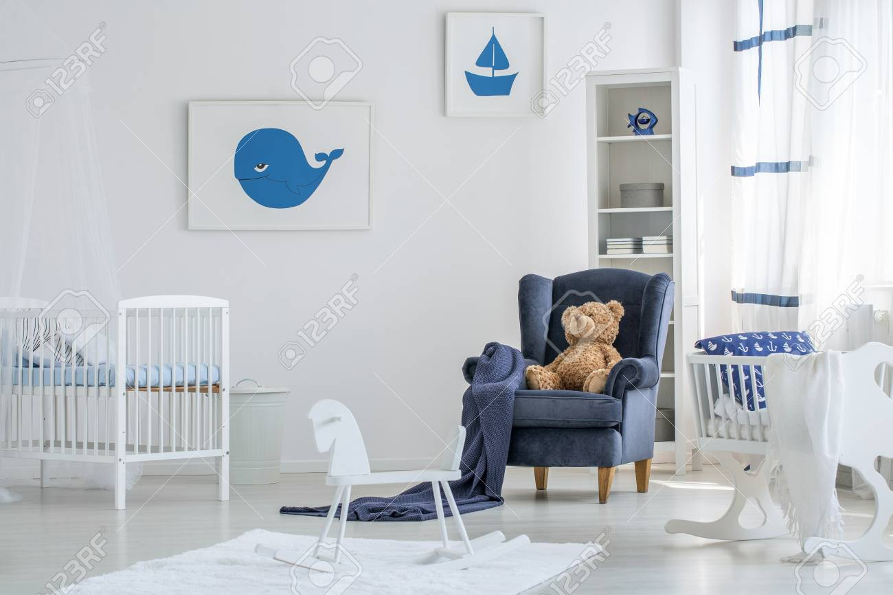 White Baby Room Interior With A Rocking Horse On White Rug And Stock Photo Picture And Royalty Free Image Image 93433581