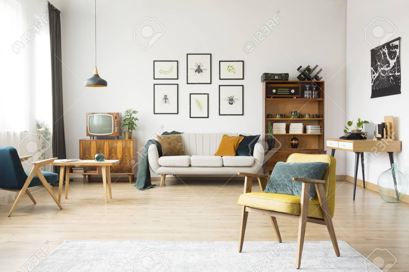 Retro Living Room Interior With Beige Sofa Against White Wall