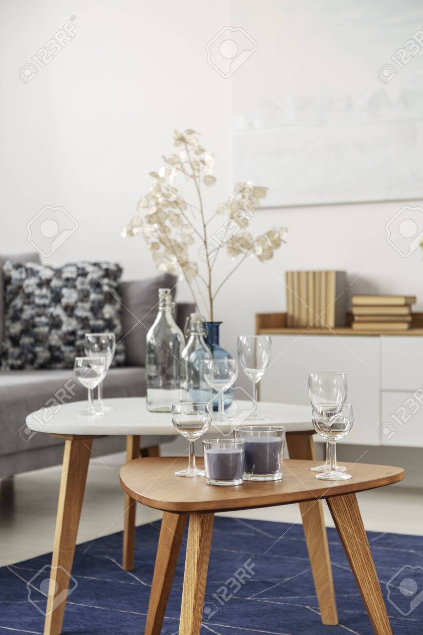 https www 123rf com photo 121512642 white glasses and candles on two small coffee tables in bright living room interior html