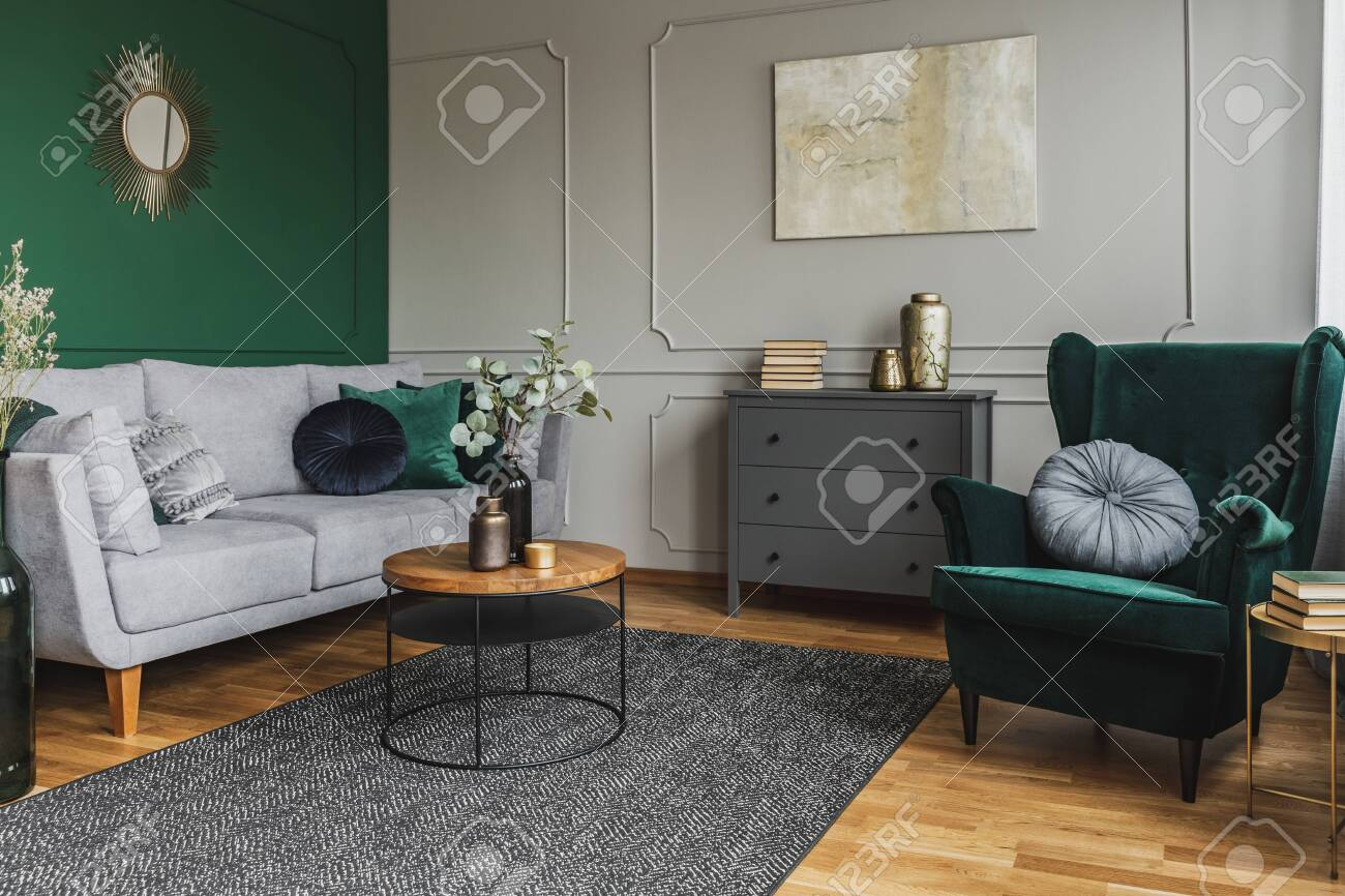 Emerald Green Wing Back Chair With Pillow In Grey Living Room Stock Photo Picture And Royalty Free Image Image 129348454