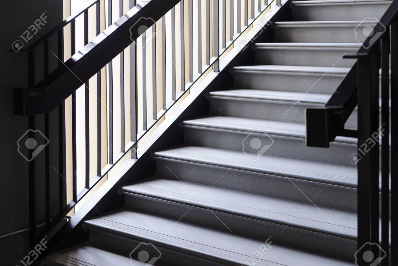 Empty Modern Concrete Staircase And Black Steel Handrail With | Steel And Concrete Stairs | Welding | Smooth | Cantilevered | Industrial | Cement