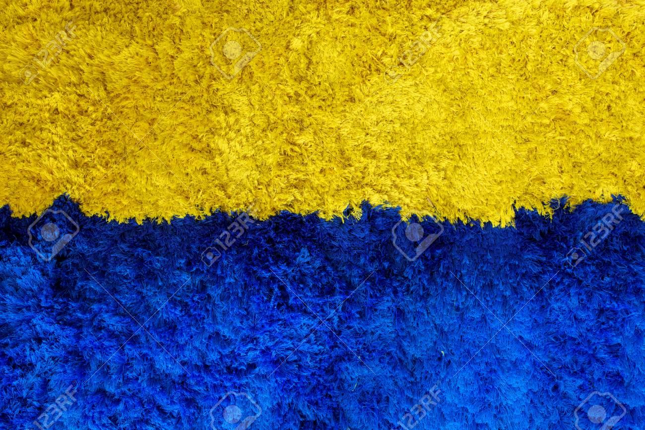 tapis bleu et jaune pour les arriere plans ou les textures