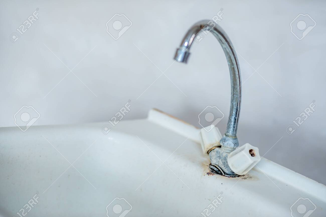 https www 123rf com photo 139687968 old rusty dirty faucet on the washstand there is no hot or cold water in the tap and the water suppl html
