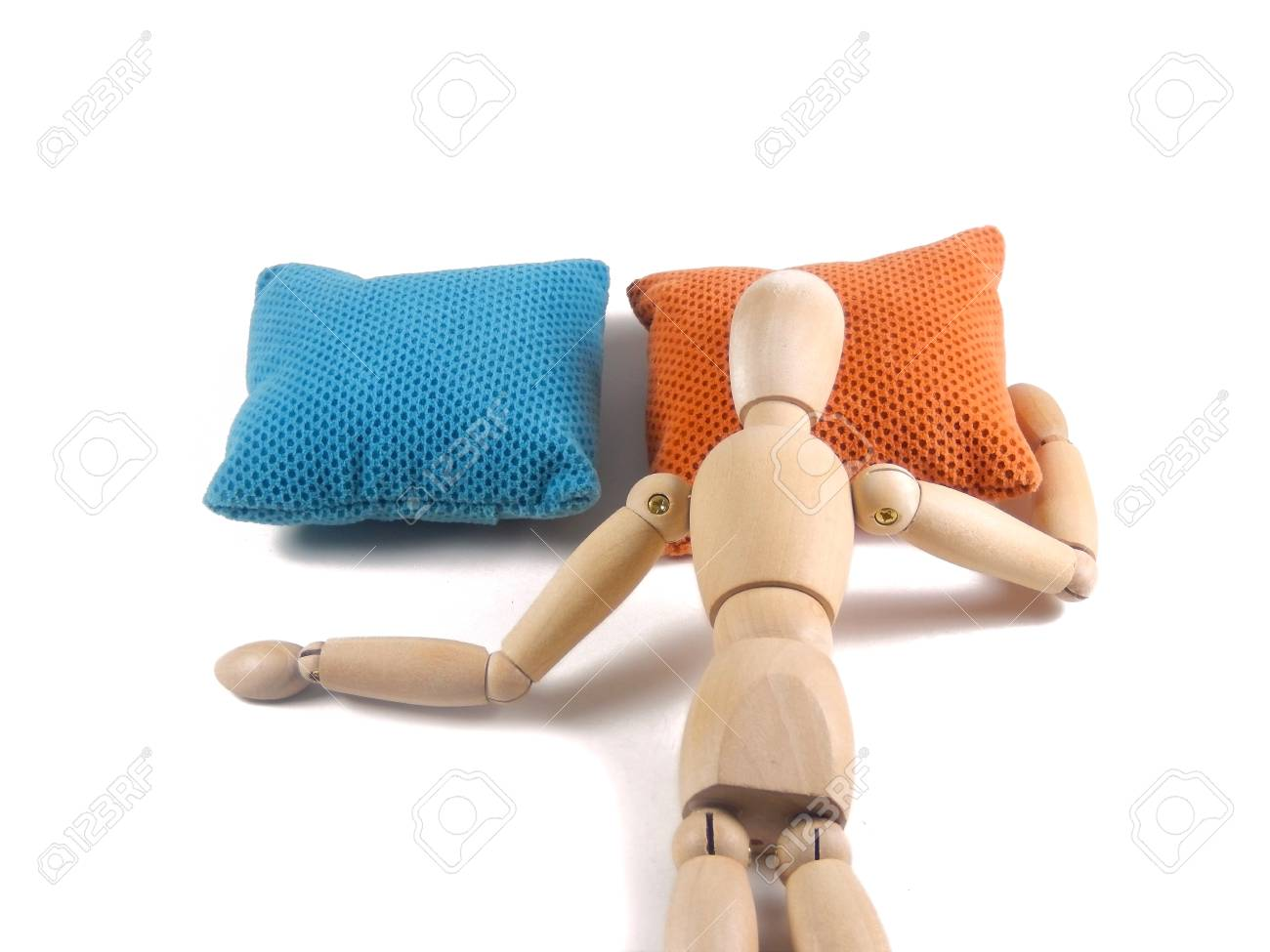 sleeping face down on bed pillow wooden doll or mannequin lying