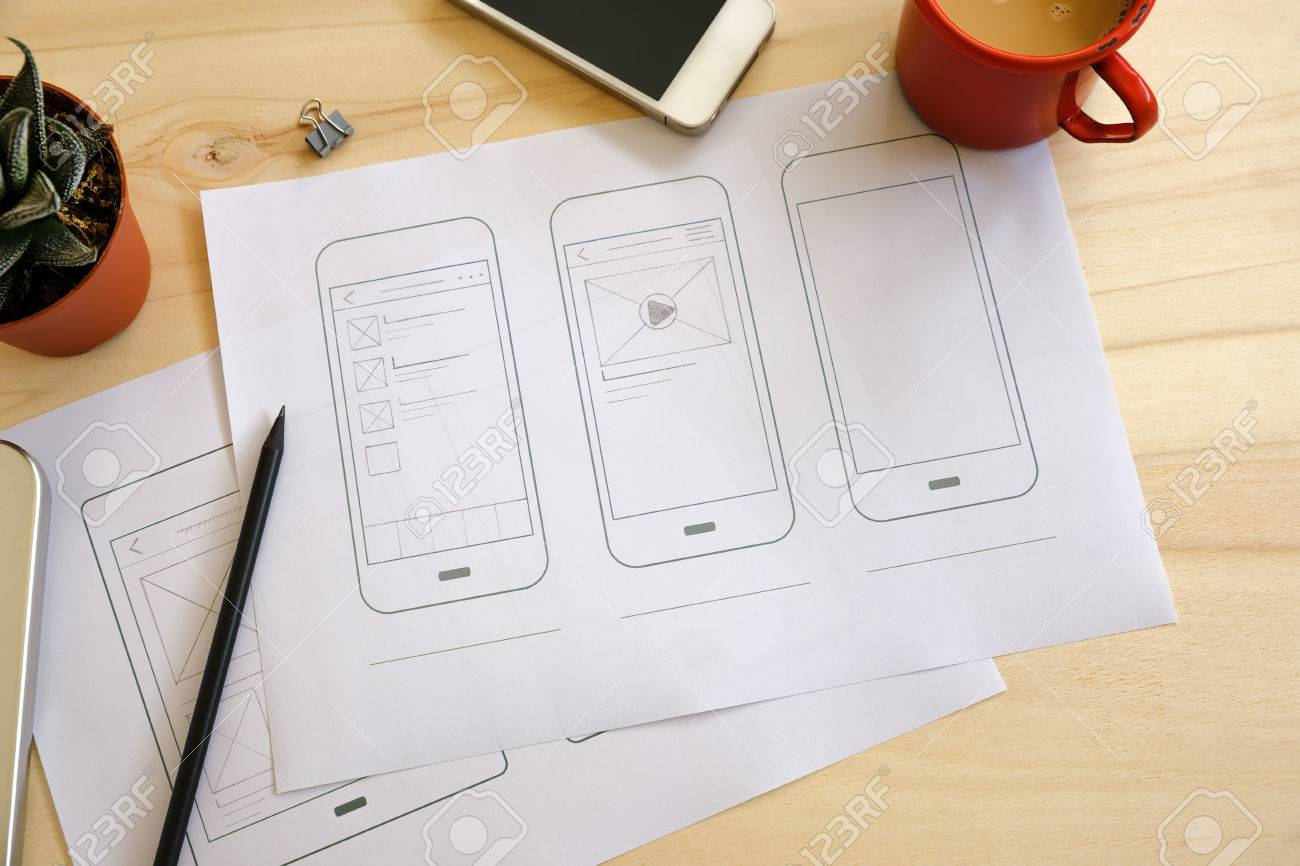 Designer Desk With UI Wireframe Sketches  View From Above Stock     Designer desk with UI wireframe sketches  View from above Stock Photo    56876022