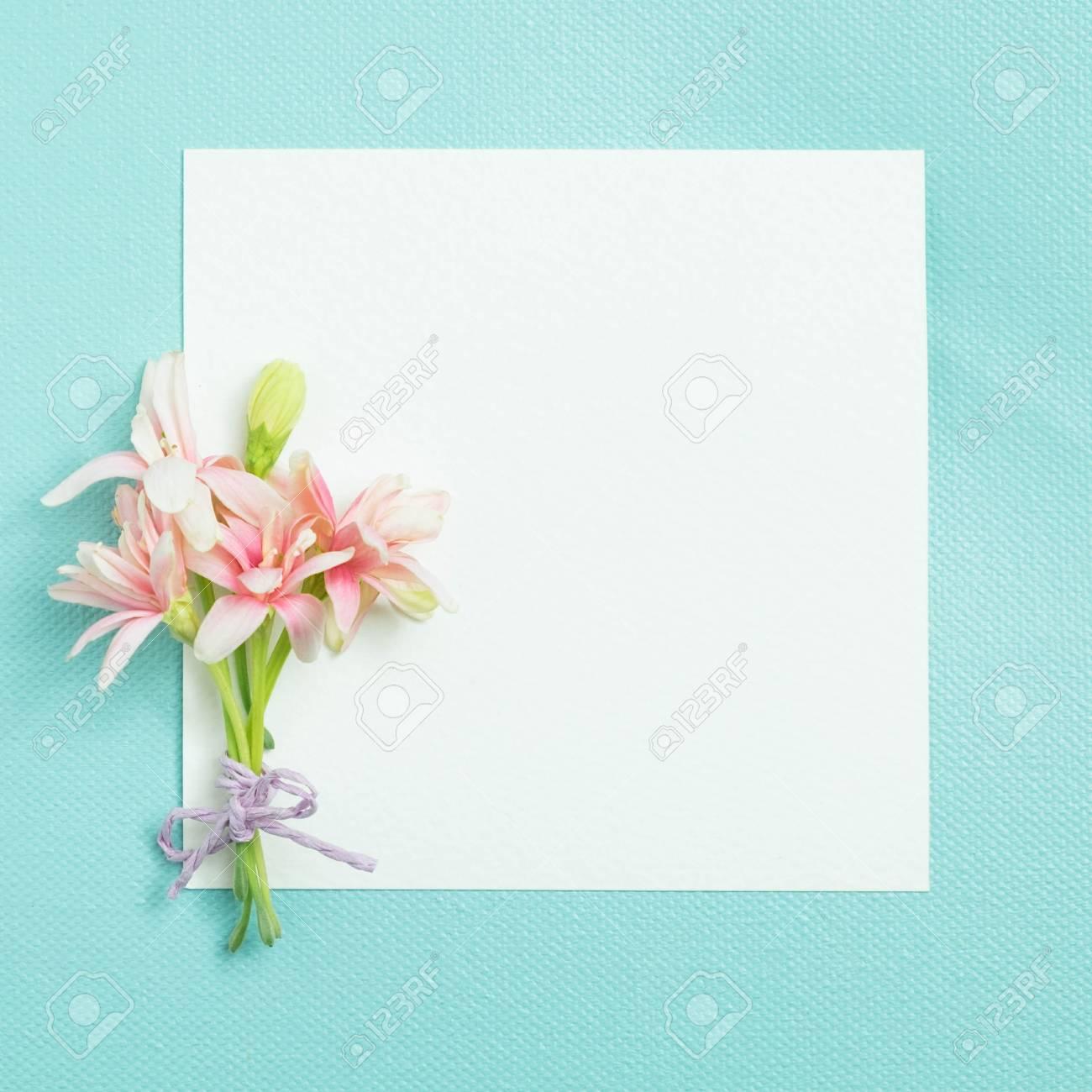 bunch of little lovely flower on white empty paper card over