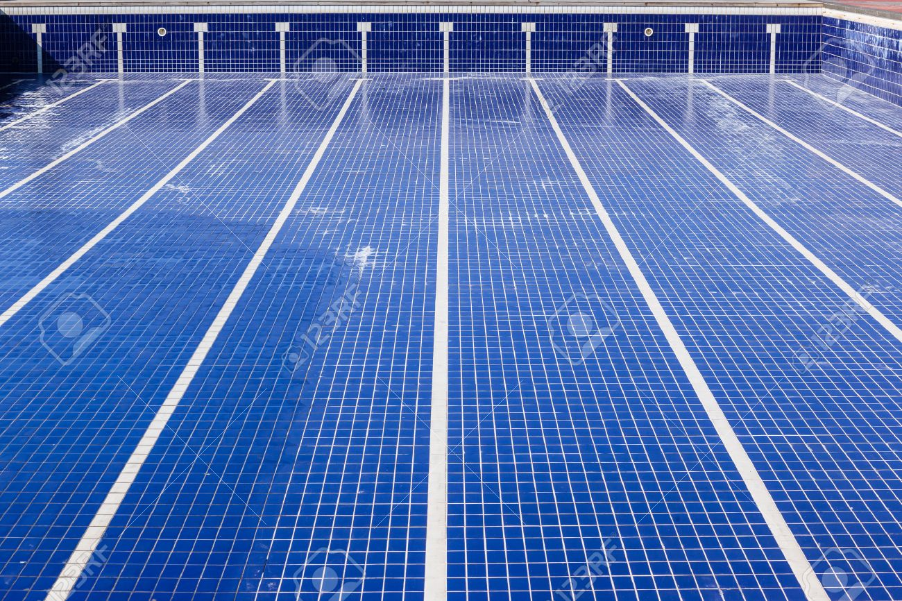 swimming pool with blue tiles with swim lane white tile markings