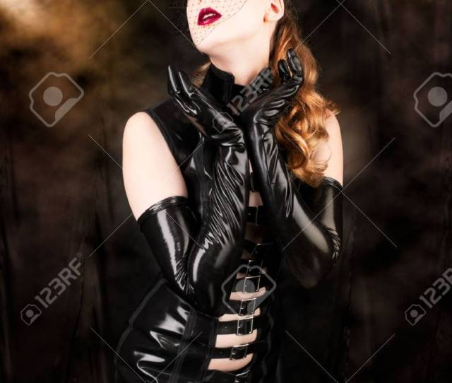 Sexy Cabaret Stage Performer Wearing A Fantasy Latex Lingerie Costume Stock Photo