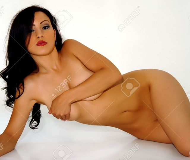 Brunette Glamour Model Nude Reclining On Side Stock Photo