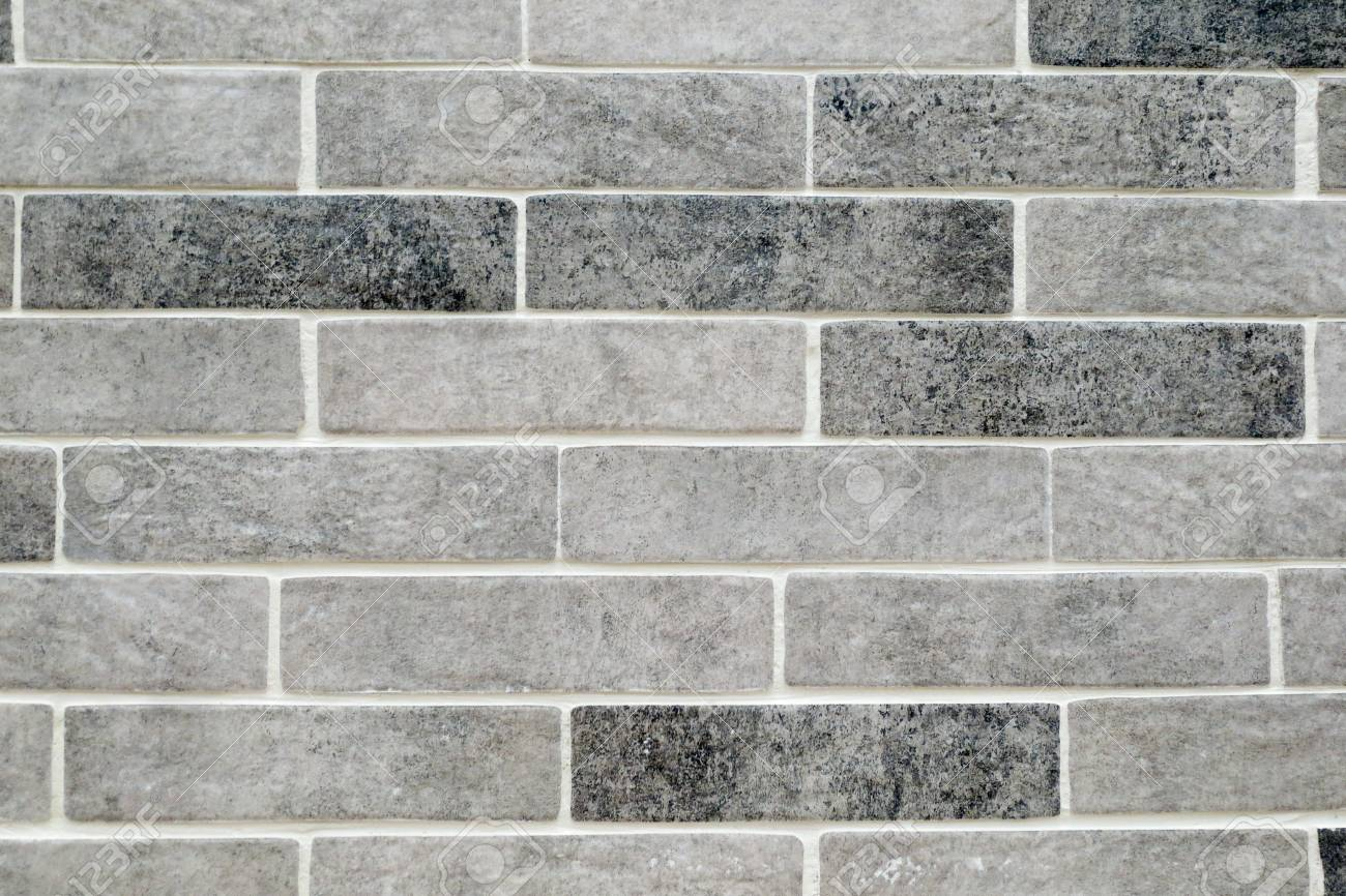 mottled grey brick tiles with white grouting background