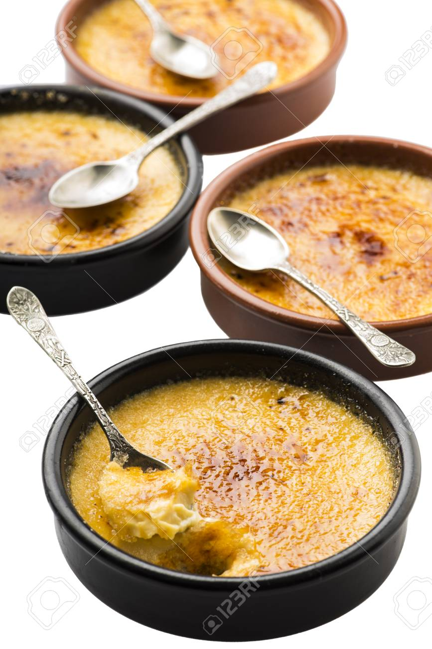 https www 123rf com photo 112518077 four creme brulee in ramequins with spoons over white background html