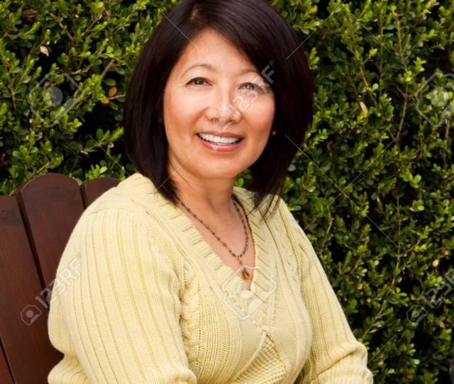 Mature Asian Woman Smiling Sitting Outside Stock Photo 74535873