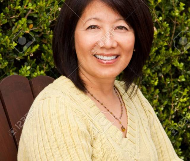 Beautiful Mature Asian Woman Sitting Outside Stock Photo 81697230