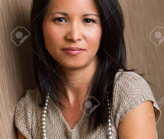 Confident Asian Mature Woman Stock Photo 83749227