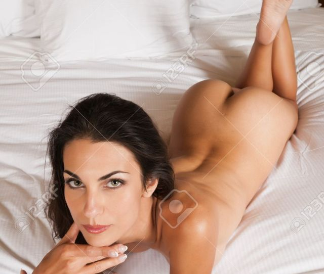 Beautiful Slender Brunette Lying Nude In Bed Stock Photo 11051339