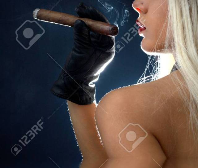 Backlight Image Of Topless Girl Smoking Cigar In Water Stock Photo