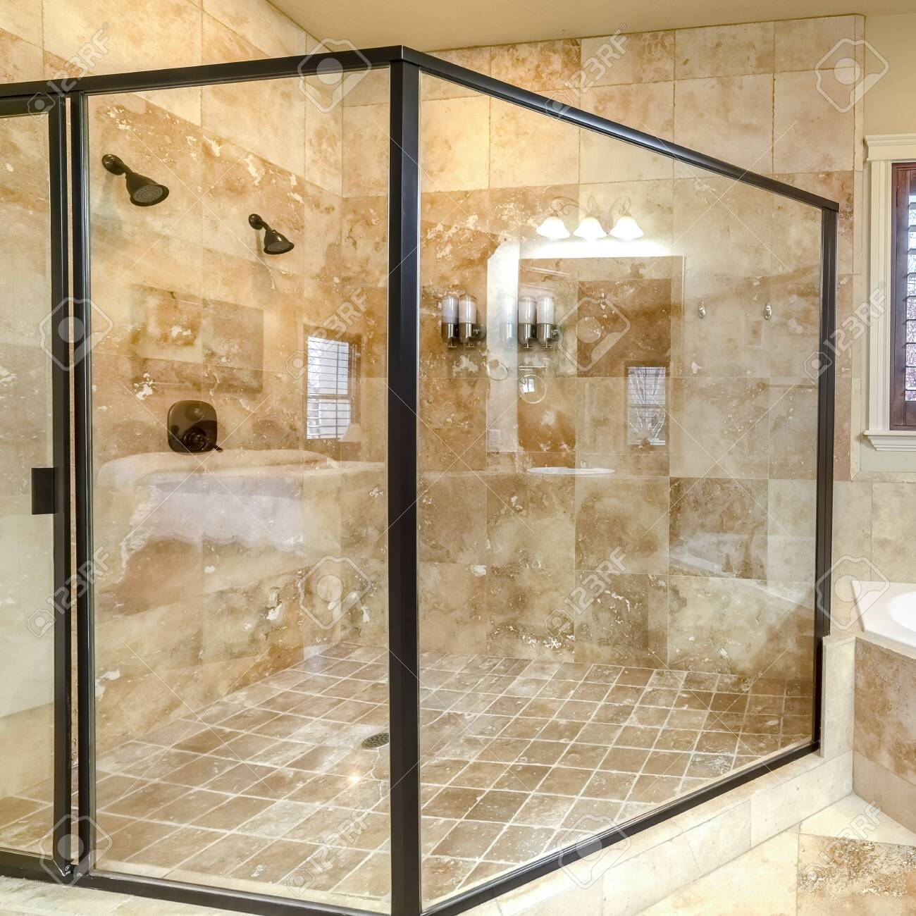 square modern luxury bathroom with glass shower cubicle fitted