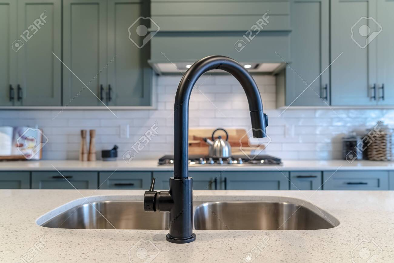 https www 123rf com photo 139153557 double bowl kitchen island sink with black faucet against cooktop and cabinets the double basin unde html