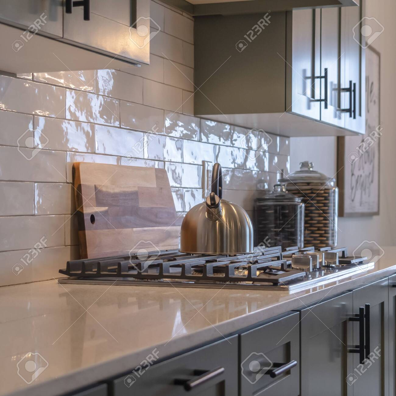 https www 123rf com photo 139157068 photo square frame kitchen work area with cabinets cooktop countertop and tile backsplash dining roo html