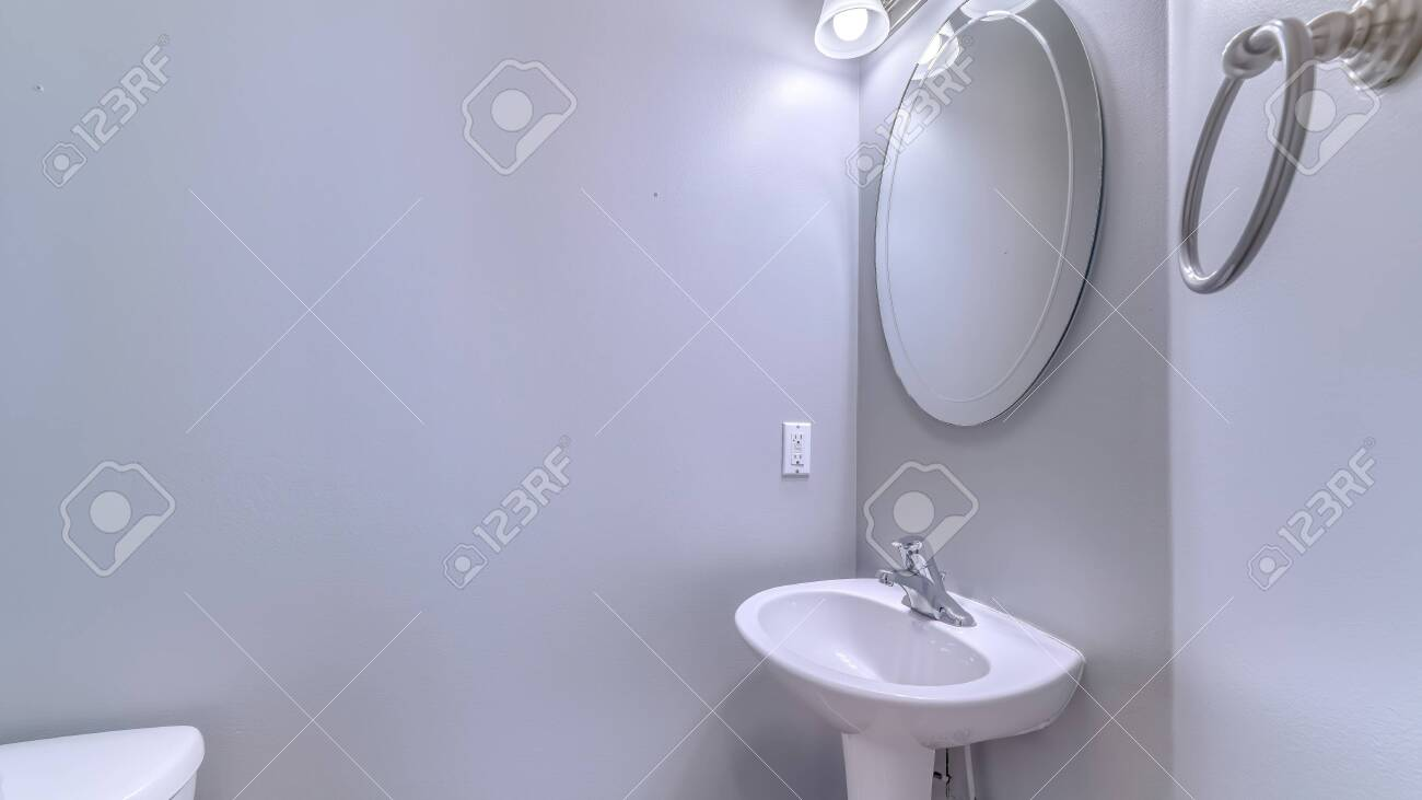 https www 123rf com photo 149182989 panorama frame bathroom interior with wall light and oval mirror over stand alone pedestal sink towe html