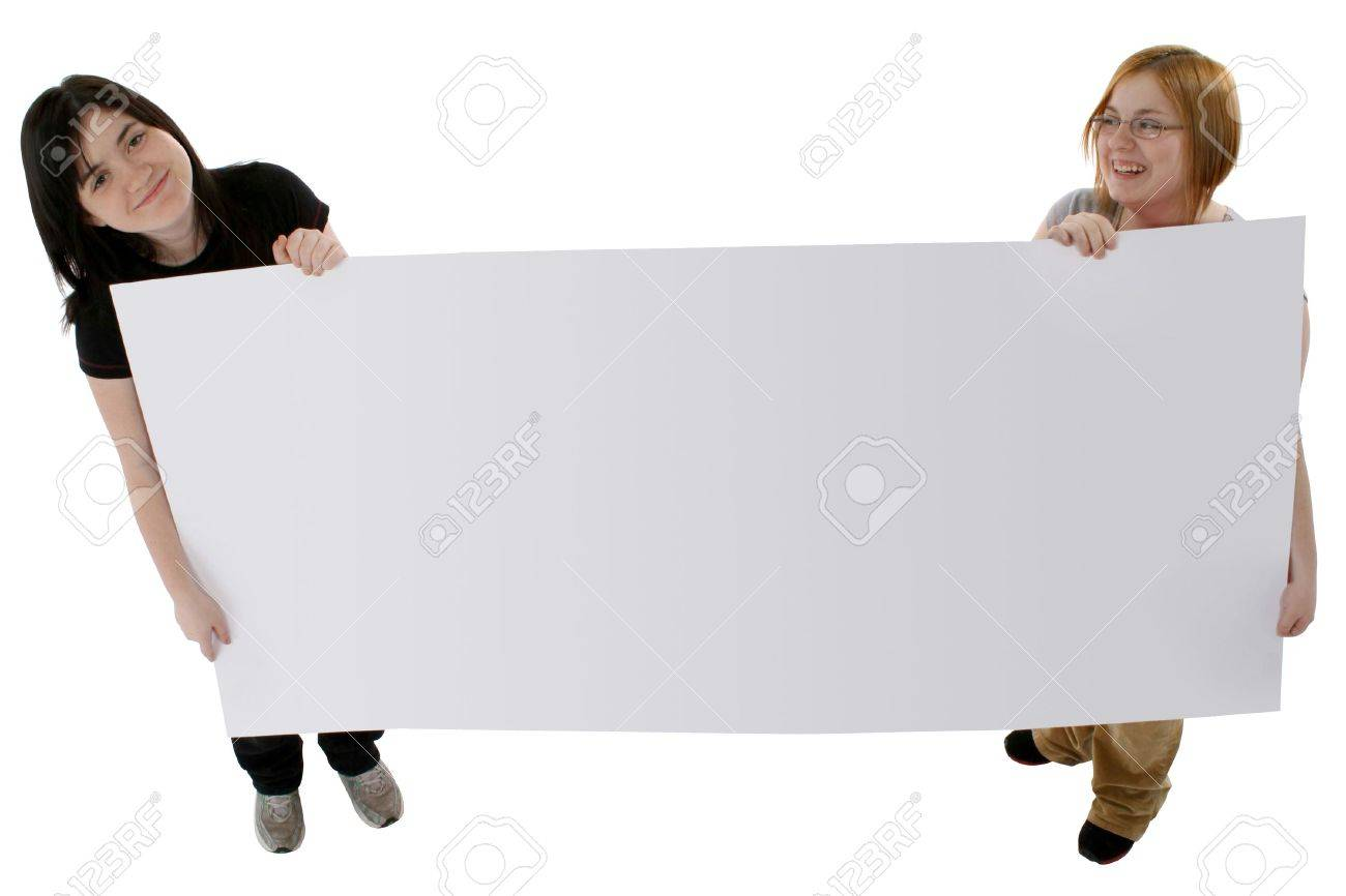 two teen girls holding large blank poster board over white